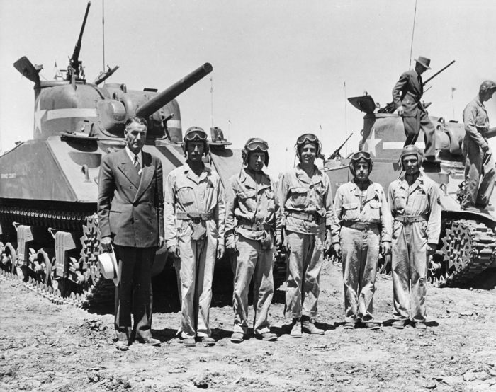 6. Camp Beale in 1943 during World War II. Although this photo was not captured in Southern California, the tank stationed behind the men was named after Orange County. Pictured here: Orange County Supervisor James A. Baker with the 13th Armored Division.