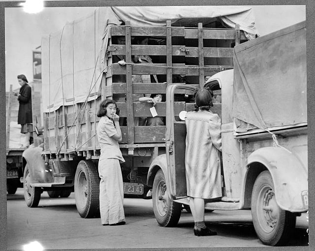 7. 1942 in San Pedro. Japanese-American residents are being relocated by truck from their homes in the surrounding area.