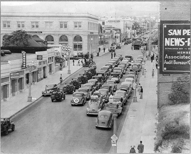 3. San Pedro in 1942. Here's a photograph of a caravan of over 70 cars during the evacuation of Japanese-Americans who were being escorted to relocation centers.
