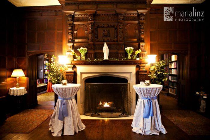 A dimly lit antique fireplace sets a romantic tone...