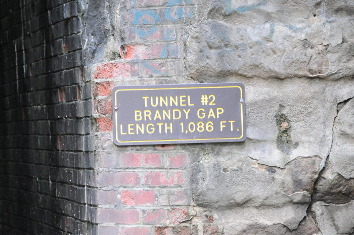 Although it's commonly referred to as the Flinderation Tunnel after Flinderation road nearby, its official name is the Brandy Gap Tunnel.
