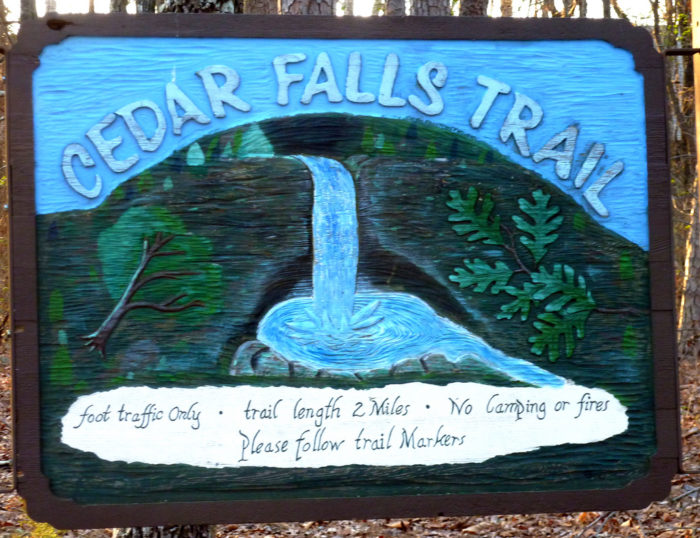 The trailhead on Cedar Falls offers an artistic preview of the wonder ahead.