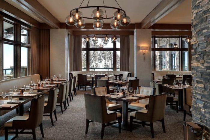 The main dining room is cozy and warm, with large windows so you can appreciate the scenery while you enjoy your meal.