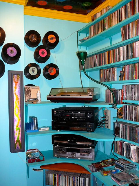 LPs, CDs, and record players fill up the music room.