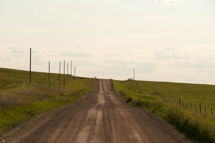 4. This dirt road traverses through the rolling hills of the prairies around Brisbane, North Dakota