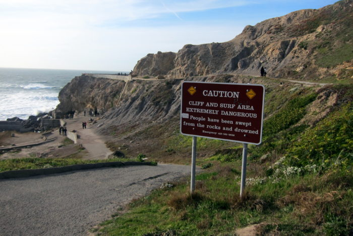 When you enter the Sutro Baths, the hike down to the tunnel is steep, and signs warn you of the dangers and past deaths that have occurred around the ruins.