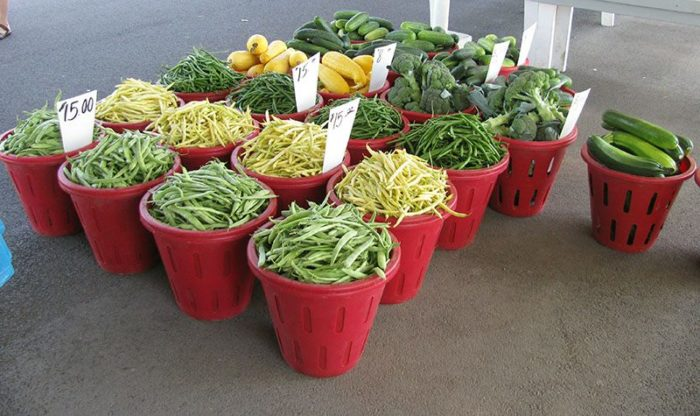 Vendors sell a variety of fresh fruits and vegetables, flowers, homemade jelly, and other homemade goodies.