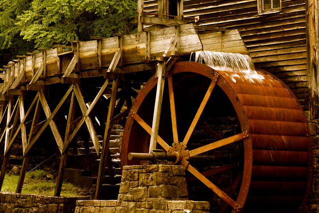 Water from the creek runs over the wheel of the mill, which grinds corn and buckwheat flour.