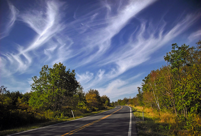 PA Route 144 affords sweeping views of the fall foliage and the sky, as illustrated in this photo taken in Sproul State Forest.