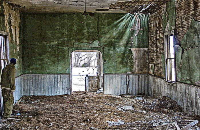 """This was taken in the now collapsed church in the Black Exoduster town of Dunlap, Kansas. The figure in this once holy, but now desolate scene lends a sense of unease."""