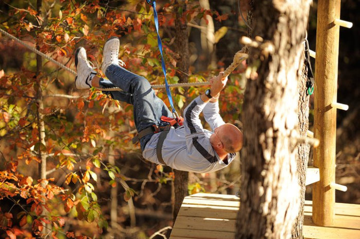 The more adventurous among us can see the fiery leaves from a zipline at Loco Ropes.