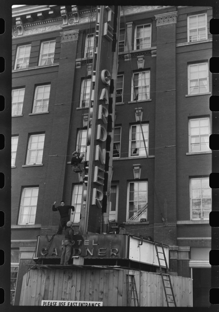 1. Workers putting up a neon sign in Fargo, North Dakota, 1940.