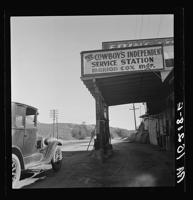 7. Along a desolate highway in Riverside County in 1937 a car fuels up at a roadside service station. I imagine having a functional car and being able to pay for gas was quite a luxury during this time.