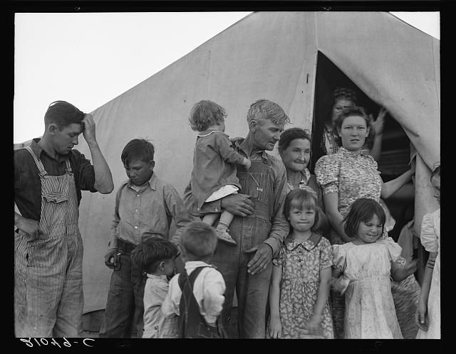 6. This family with 11 children scrapes by in Imperial County and works the farm during pea harvest to support the family. Pictured here in 1939.