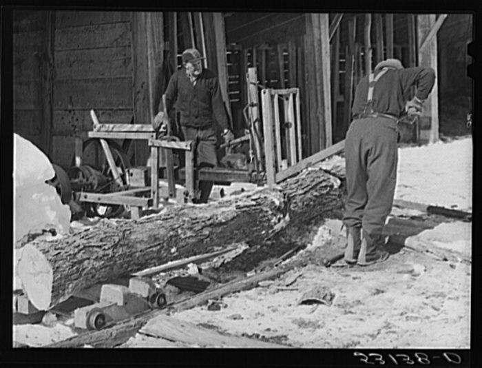 5.  Sawing wood on a farm.
