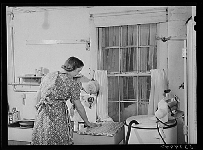 15.  A Vermont homemaker fixing supper on a winter night.