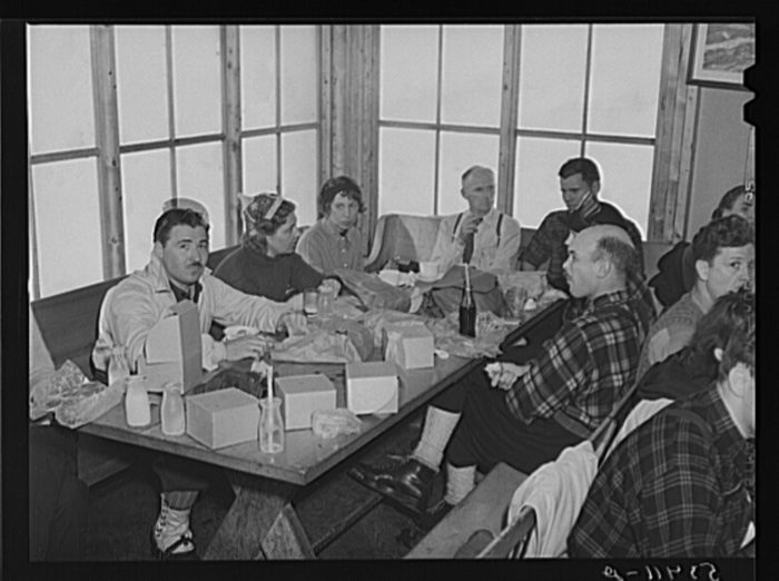 14.  Skiers eating lunch in tollhouse at the foot of Mount Mansfield.
