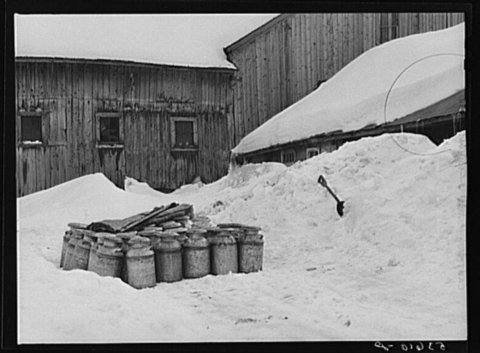 17.  Farmhouse and milk cans near Saint Johnsbury.