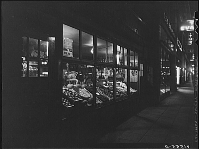 9. The illuminated store front window full of produce in a shop in Fargo, North Dakota, 1940.