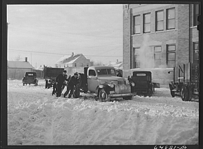 8. Getting a truck out of the snow in Hettinger, North Dakota, 1942.