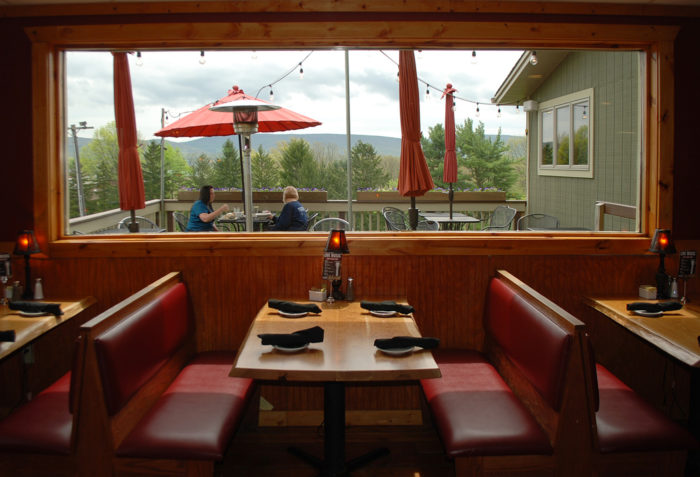 Sit back and relax at one of the tables or sink into a comfortable booth overlooking the deck.