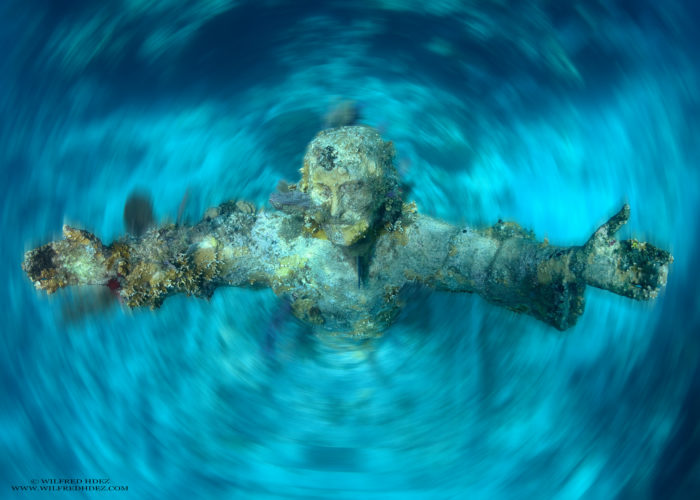It would be an impressive piece of art on dry land, but something about its underwater surroundings make it even more beautiful and expressive. Some people might feel a sense of sadness seeing the sunken statue, but for others it's awe-inspiring.
