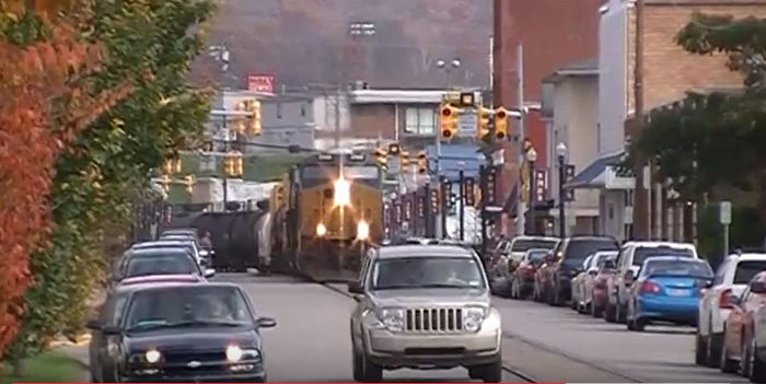 Freight trains pass through the town, and share the same road as the cars.