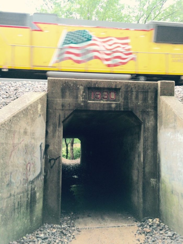 You'll go through and old tunnel that crosses underneath the Union Pacific Railroad.