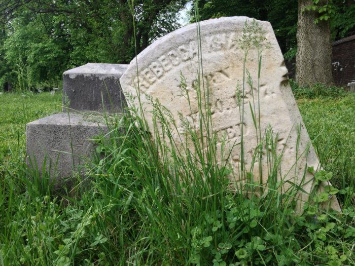 Crooked overgrown headstone