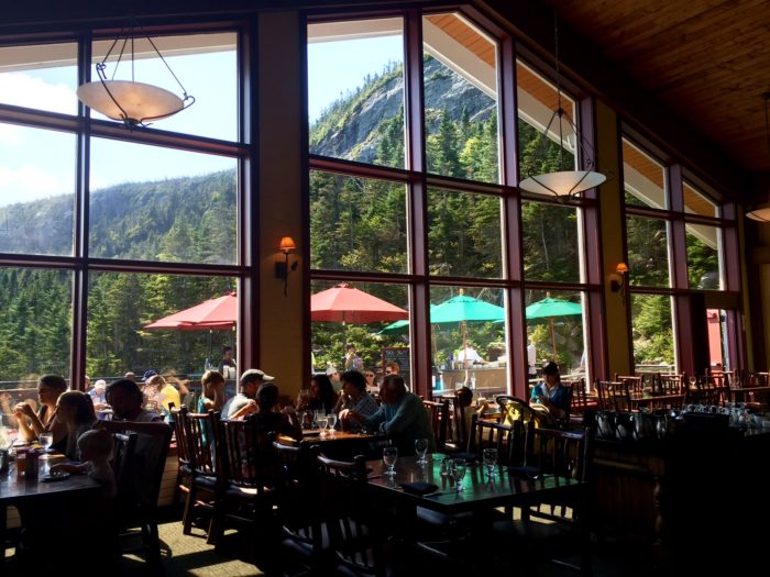 The windows frame the surrounding alpine peaks for an added effect.