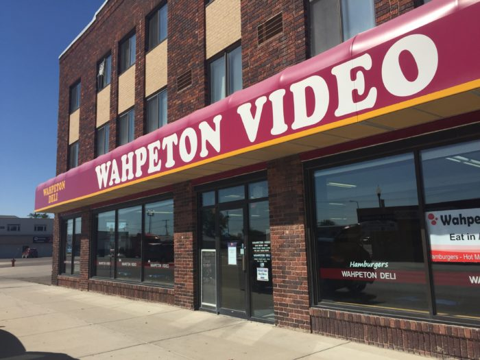 The video store gets first billing on the outside, of course.