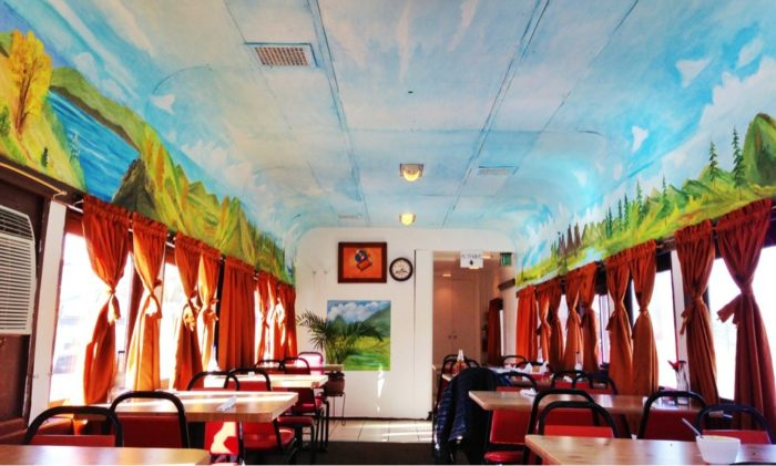 The inside has been completely repainted with a ceiling mural to brighten the original wood-paneled interior.