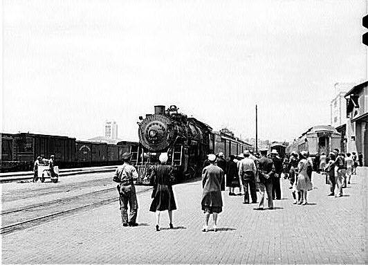 5. Outside San Diego Union Station in 1941. You can see the train from Los Angeles pulling into the station when this photo was captured.
