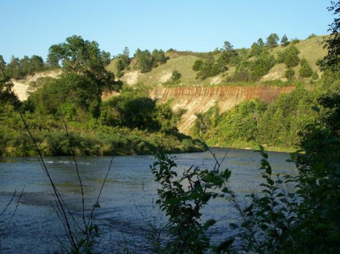 The trail skirts the scenic river, letting you drink in the sights of the gorgeous bluffs and lush vegetation.