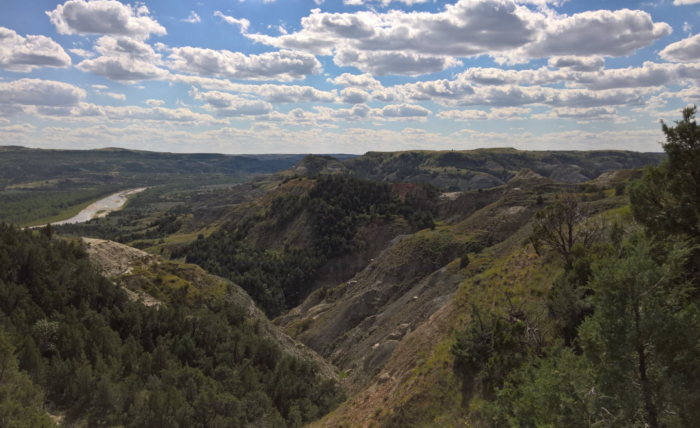 The trail will descend and loop back to the trailhead, still offering glimpses of the beauty that is the North Dakota badlands.