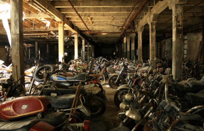 Hiding within a warehouse that was built sometime in the 1800s, the motorcycle graveyard of Lockport was once home to a thriving business.