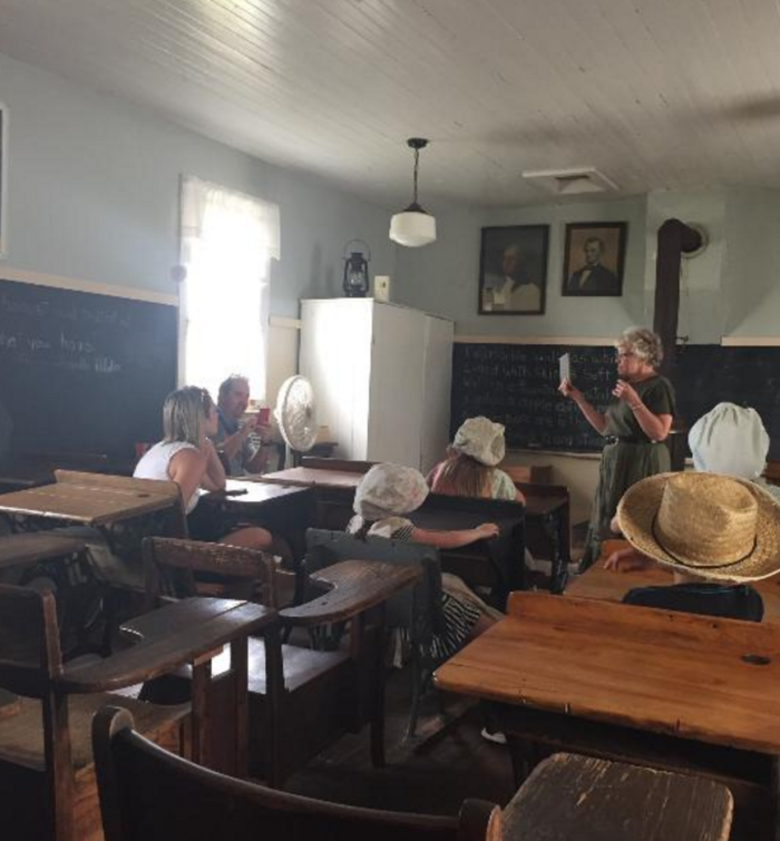 Beyond the houses, you can visit the schoolhouse for a lesson...