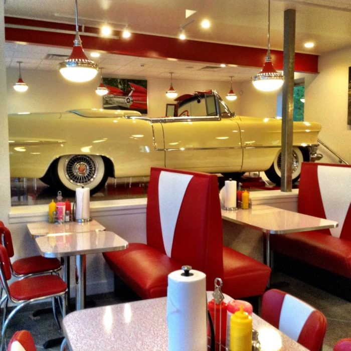 The interior looks like a classic 1950s diner, down to the checkered floor.
