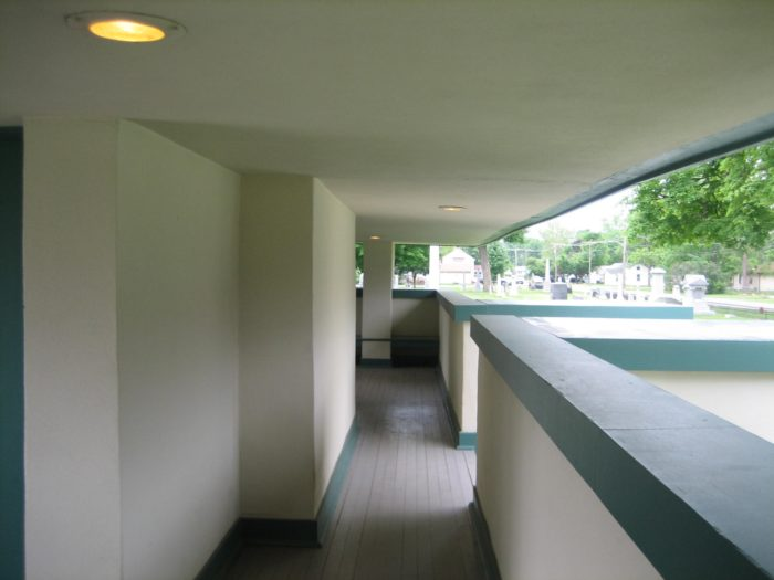 The exterior hallways were meant as waiting areas for those as cars approached to pick them up.