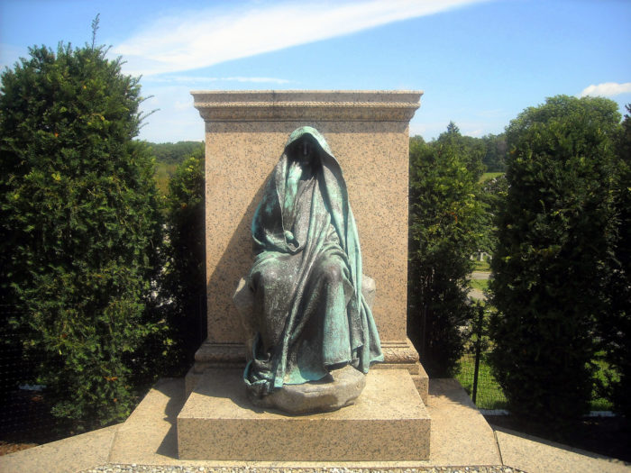In 1886, after traveling in Japan, Henry committed sculptor Augustus Saint-Gaudens to sculpt a memorial to Clover as a bronze statue and to use the Buddhist philosophy's ideas on grief as inspiration. Because of this, the sculpture is not actually a sculpture of Clover. It is an androgynous and anonymous  figure that represents Henry's emotions around her death.