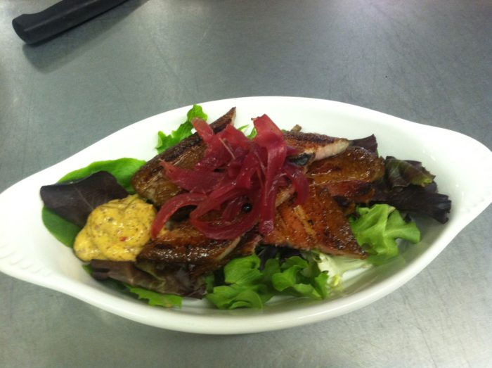 ...New twists on old favorites like house cured bacon served with spicy mustard and pickled onions...