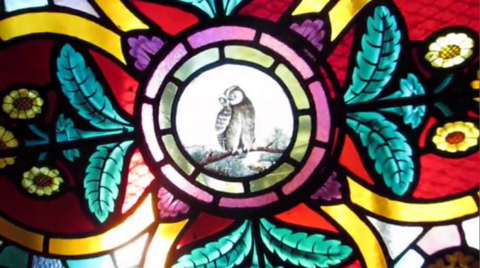 While stained glass designs decorate the ceiling, making for one glorious skylight.