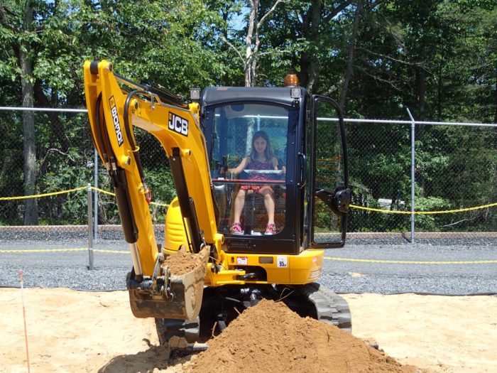 "Equipment has been modified so that guests as small as 36"" can safely drive full size backhoes and dig giant holes with real excavators."