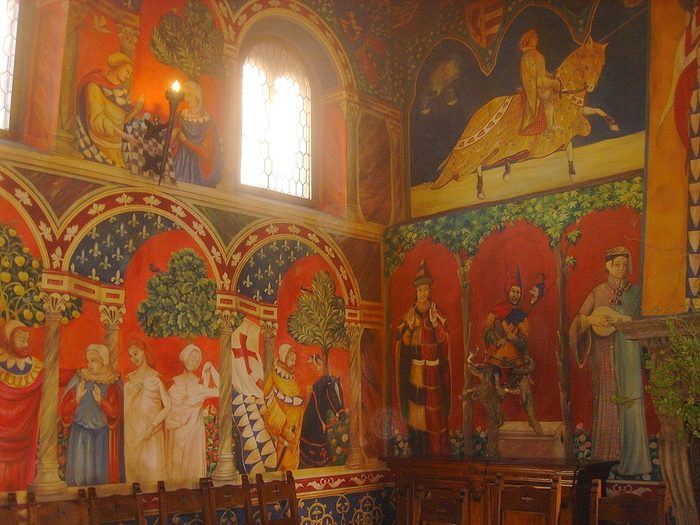 Frescoes are on the walls in vibrant colors. Painted by two Italian painters, it took them over a year to complete.