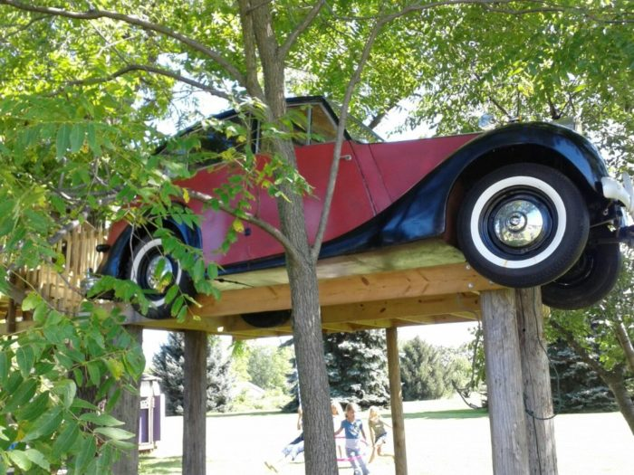 One of the first things that may catch your eye is the vintage car on one end of the treehouse village.