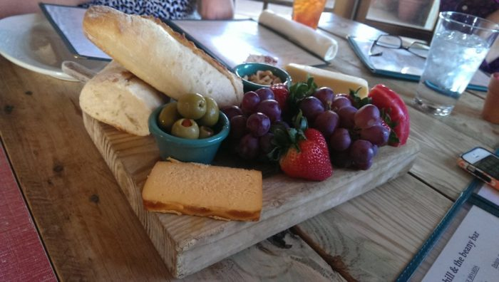 Start your meal off with a cheese board - three to five cheeses, grapes, strawberries, olives, bread and mixed nuts. It is delicious!