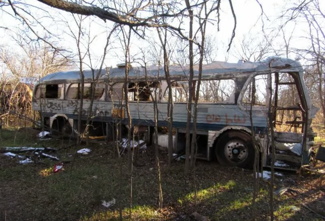 It is still a mystery why everything was left abandoned. That's part of the creepiness about the place...the lack of history about its demise. I wonder how long this burned and abandoned bus has been withering away?