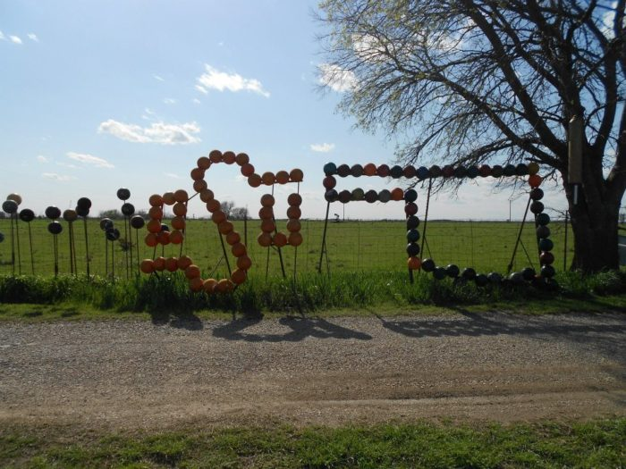 The first project that Chris Barbee created was the fence. You'll find all sorts of creative art along the fence line, like this OSU and state logo.