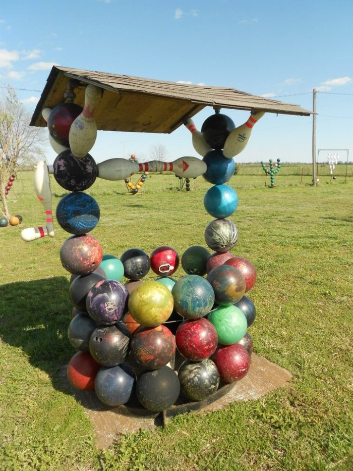 Check out this piece of art...a water well made from an assortment of colorful bowling balls.