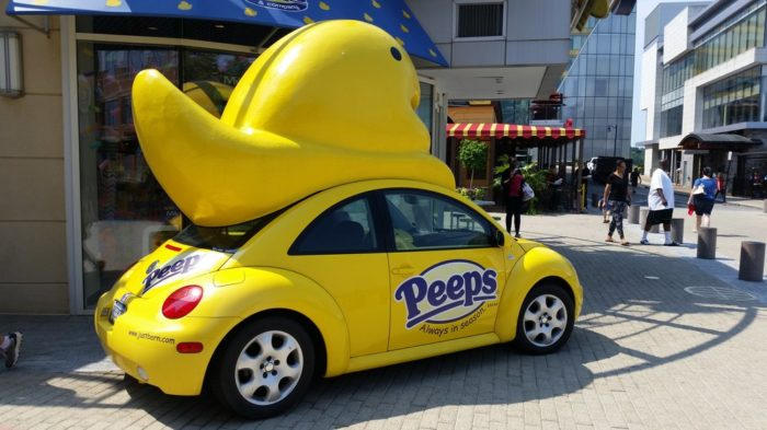 """Mostly because it has a bright yellow VW Bug with a large """"Peep"""" on top, otherwise known as the Peepmobile. It makes for a great photo op because who can resist a giant peep?"""